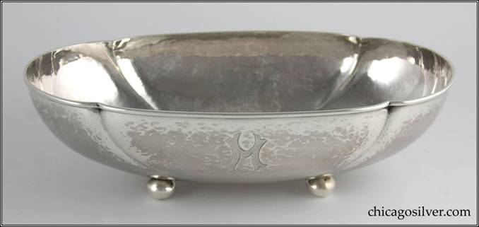 "Kalo bowl, oval, on four ball feet, with four lobes, flat bottom, applied wire on rim, engraved ""M"" on side"