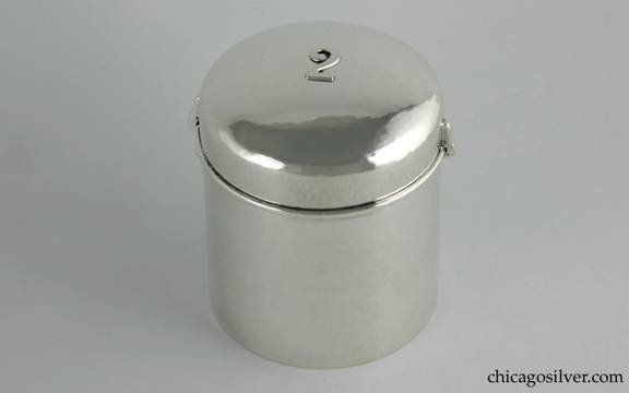 "Kalo box in the form of an air-tight canister, silver, cylindrical, with snug, domed lid that centers an applied ""2"" numeral."