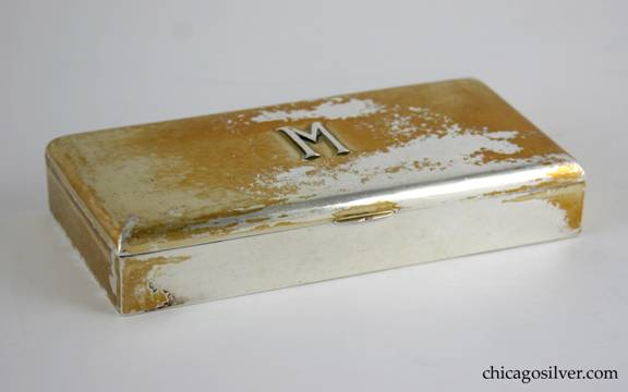 Kalo box, silver, rectangular, with flat lid that has curved edges, on long hinge.  Applied M on lid.
