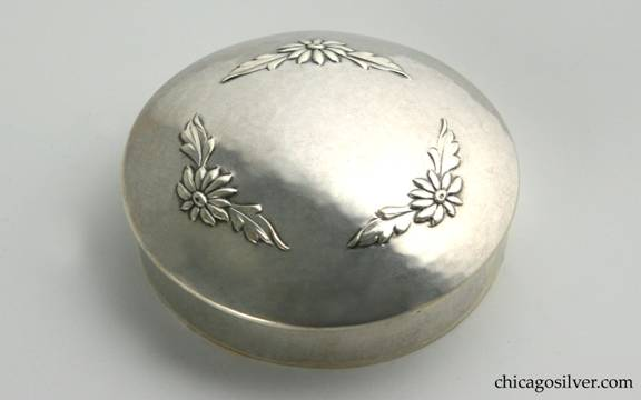 Kalo box, small covered, hammered surface with domed cover, which has chased and repousse floral decorations in circular pattern.