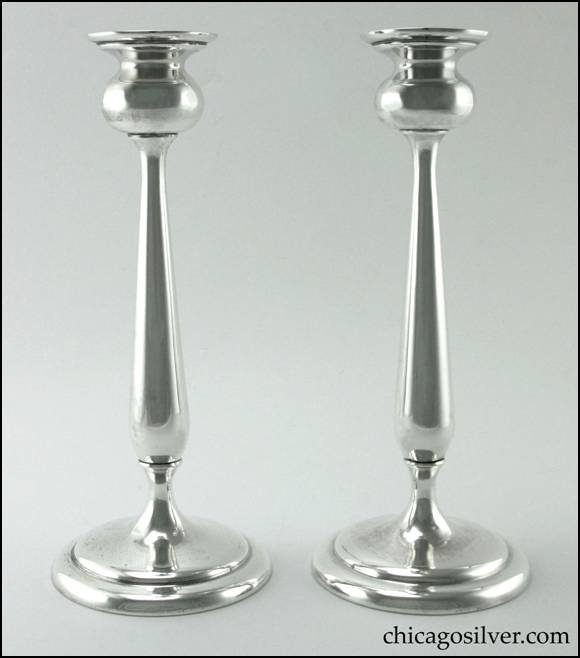 Edward H. Breese candlesticks, pair (2), tall tulip form, with flaring bulb-shaped cups, tapered stems widening at the bottom, and round gently stepped bases.
