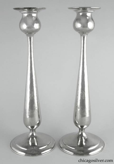 "Kalo candlesticks, tall, pair (2), monumental in tulip form with broad flange at top. Nicely hammered.  15"" H and 5-3/8"" W at base and 3-3/8"" W at top.  Marked:  STERLING / HAND WROUGHT / AT / THE KALO SHOP / G152H"