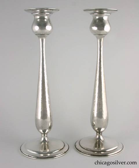 "Kalo candlesticks, tall, pair (2), monumental, with stepped circular foot, in tulip form with broad flange at top. Nicely hammered.  14-1/8"" H and 5-1/4"" W across base and 3-7/16"" W across top.  Marked:  STERLING / HAND WROUGHT / AT / THE KALO SHOP / G152H"