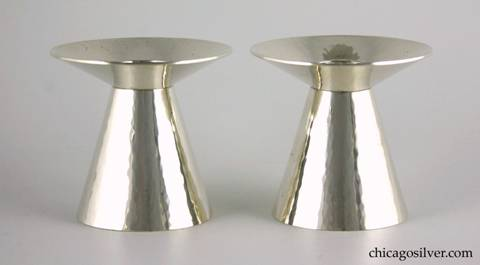 "Kalo candlesticks, pair (2), with flared cone-shaped bodies tapering to wide upturned round wax catches each centering a small cylindrical bobeche.  Modern styling.  Very heavy.  Lovely hammering.  Pristine unused condition.  3-1/6"" W and 2-7/8"" H.  Marked:  STERLING / HAND WROUGHT / AT / THE KALO SHOP / C11"