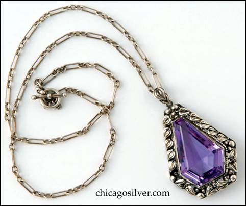 "Pendant, 2"" H, on chain 19"" L.  Handwrought in sterling silver by James Scott of the Elverhöj community, the pendant features elegantly fashioned leaves and beadwork forming a border around a central teardrop-shaped faceted amethyst."