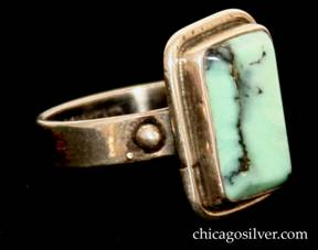 Forest Craft Guild ring, silver, with rectangular frame centering a rectangular veined green-blue laramar stone, with small beads at the sides.
