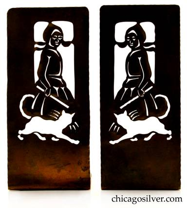 Forest Craft Guild bookends, brass, pair (2), tall, with intricate cutout pattern of Dutch girl with running cat at her feet, hammered edges