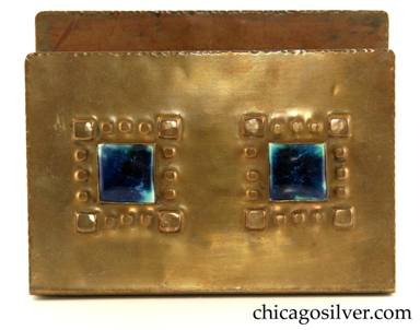 Forest Craft Guild letter holder, brass, with two square blue inset tiles each surrounded by repousse pattern of four larger squares at the corners of the tiles, with three smaller squares in between forming a border.  Rounded corners and hand-worked edges.