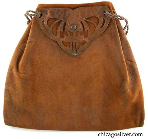 Forest Craft Guild handbag, ooze leather, trapezoidal, with hammered copper hardware at top.  One side has riveted triangular copper form with many cutouts.  Other side has simpler copper riveted form. Original twisted silk cord handle.
