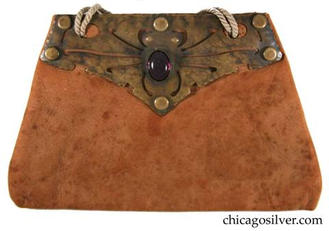 Forest Craft Guild handbag, ooze leather, lined, trapezoidal, with riveted cutout and repousse brass hardware at top centering an oval purple bezel-set stone on each side.  Original twisted cord handle.