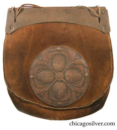 Forest Craft Guild handbag, ooze leather, with flat top and rounded body and curved copper hardware at top plus separate large riveted round very detailed and elaborate repousse copper decoration below one front with geometric floral design.  Original braided cord handle.