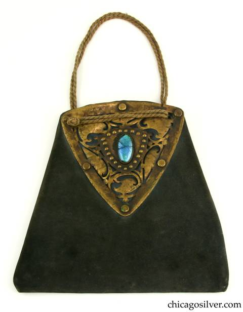 Forest Craft Guild handbag, trapezoidal, blue-grey ooze leather, lined, with large riveted and saw-pierced triangular brass hardware on both sides, each centering a blue-green oval bezel-set cabochon foil-backed glass stone.  Twisted silk cord handle.