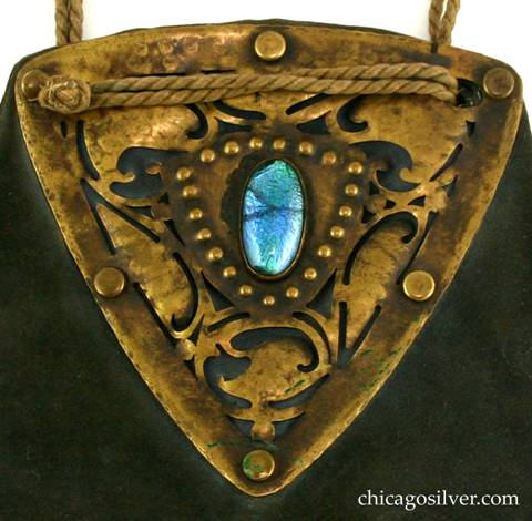 Forest Craft Guild handbag, detail, showing extensive cutout decoration and central foil-backed glass stone.