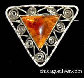 Forest Craft Guild brooch, triangular, silver, centering triangular bezel-set amber stone, with coiled wirework frame.