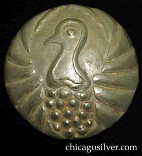 Forest Craft Guild brooch, brass, gilded, round, very large, with striking repousse image of bird's head and neck at center, with stylized feathers below and stylized wings arching around the sides to the top.