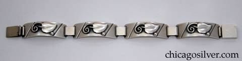 Laurence Foss bracelet, four convex rectangular links each with an applied leaf with curving wire ornament and single bead.  Links are joined by heavy silver loops.