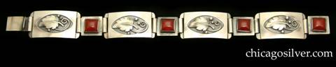 Laurence Foss bracelet with carnelians.  Four convex rectangular links each centering a recessed oval that contains an applied leaf with three silver beads and spiraling wire details, interspersed with four smaller square rectangular links each centering a square bezel-set carnelian stone.