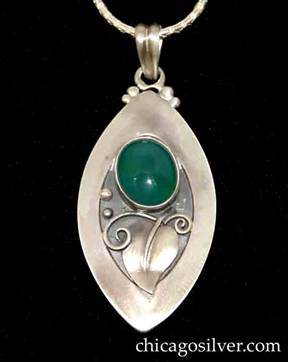 Foss pendant on chain, oval, with pointed ends, oxidized background, wide raised edge, applied stylized pointed leaf, silver beads and wirework ornament, and large oval bezel-set green agate stone.