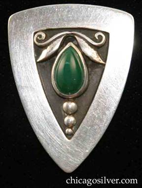 Foss brooch / pendant with green stones.  Triangular brooch with curved corners and edges, loop on back for use as pendant, triangular inset at center with oxidized background with applied leaves and scrolls on top, row of three vertical beads at bottom, centering tear-shaped bezel-set green cabochon stone.