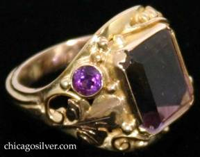 Laurence Foss ring, 14K gold, centering large purple/yellow ametrine rectangular faceted bezel-set stone, with a small round faceted citrine bezel-set stone on one side and a small round faceted amethyst bezel-set stone on the other, surrounded by lovely bead and wirework ornament and an applied chased leaf on either side.  Very much in the style of Edward Oakes.