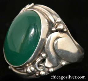 Laurence Foss ring, silver, large, with large oval bezel-set cabochon deep green onyx stone in prominent bezel frame surrounded by an applied stylized tulip flower and beads and wirework decoration on each side.  Heavy.