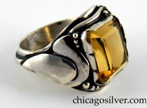 Laurence Foss ring, silver, with large rectangular bezel-set open-back citrine, with a curving applied leaf on one side, a tulip blossom on the other, tiny beads and wire decoration around the stone, and larger beads and a thicker applied wire that runs around the back of the shank.
