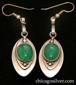 Laurence Foss earrings, pair (2), drop, for pierced ears, oval form, each with a smaller applied oval centering an oval bezel-set cabochon chrysoprase stone with bead ornament top and bottom.  S-shaped strap wire link through one end of a loop at the top connected to a hook at the top with spiraling wire and bead detail.
