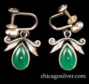 Laurence Foss earrings, pair, screw-back, with teardrop-shaped green bezel-set stones below hammered leaves and scroll decoration.