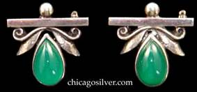 Laurence Foss pins, small, pair, teardrop-shaped green bezel-set stones below hammered leaves and scroll decoration.