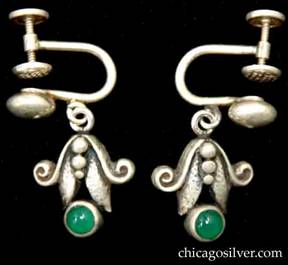 Laurence Foss earrings, pair, with small round green bezel-set stones below deeper hammered leaves, scroll and bead decoration.