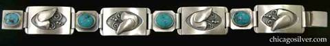 Laurence Foss bracelet, link, with turquoises.  Four large rectangular convex links alternating with four smaller ones.  The large links have applied stylized Jensen-type doves with beaded and curving wire ornament, inside an oxidized oval recessed frame.  The small links have oval bezel-set cabochon turquoise stones and clipped corners.