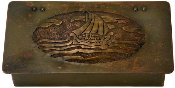 Frost brass cigarette box with hinged lid and hand-worked and acid-etched decoration of ship at sea.