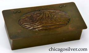 Frost box, brass, with overhanging hinged lid and hand-worked, acid-etched domed oval decoration on lid of Viking ship at sea under cloudy sky.  Ooze leather lining. Riveted hinges.  Frost catalog calls this a cigarette box.