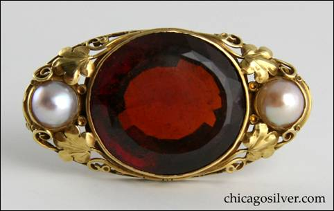 Edward Oakes gold pin with faceted orange-red hessonite garnet, flanked by two pearls