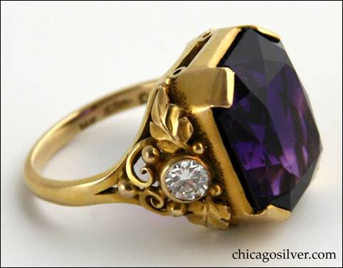 Gilbert Oakes gold ring with central faceted amethyst with deep color, flanked by bezel-set diamonds