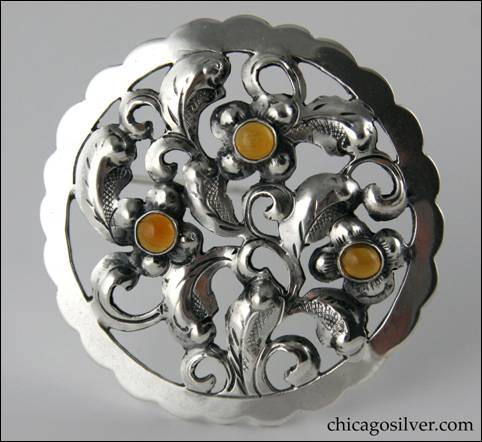 Yngve Olsson round pin with amber stones