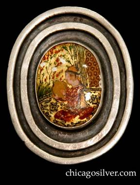 Mary Gage pin, oval, with two thick silver rings centering a bezel-set multi-color oriental-themed painting or enamel