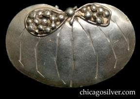 Mary Gage pin, lily-pad form, with chased ribs, and horizontal hourglass shape made of applied wire at top filled with silver beads and centering larger silver bead
