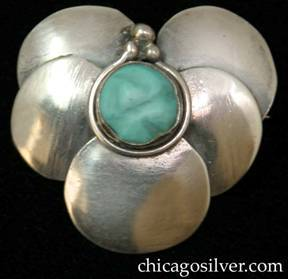 Lillian Pines brooch / pin, composed of five overlapping circles in a heart-shaped arrangement, centering a carved bezel-set turquoise stone with a decorative wire around the bezel and three small beads on top.