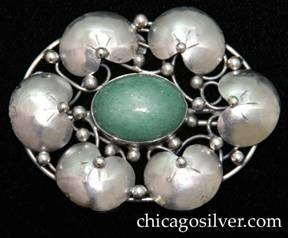 Lillian Pines brooch / pin, oval, composed of six chased lily pads surrounding a central bezel-set oval green speckled aventurine cabochon stone, with applied beads and vines on an oval frame with underlying irregular wirework supports.