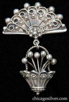 Lillian Pines brooch / pin, fan-shaped with drop made of small 3-dimensional ornamented bucket containing bead-like flowers with flowers and beads on the side and twisted rope handle.