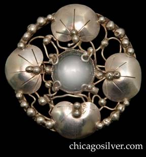 Mary Gage brooch, with four chased lily pads centering a round moonstone or rock crystal on a round frame