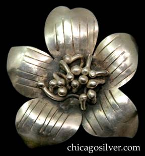 Mary Gage pin, in the shape of a chased and repousse flower blossom with five petals centering a thicket of stamens with beads at their ends