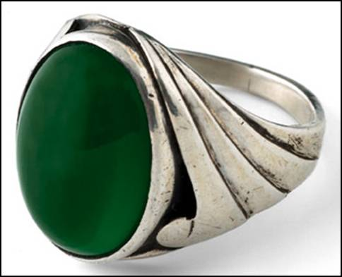 Bjarne ring, in handwrought sterling silver with large oval cabochon green bezel-set chalcedony stone