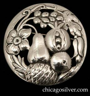 Randahl brooch, round, with chased and cutout blossoms, leaves, and fruit on a slightly convex circular frame.  One of the largest and nicest executions of a Randahl pin that we've seen.