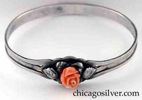 Kalo bracelet, bangle, with carved pink coral rose centered by pierced cut-out and applied silver leaves