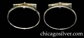 Kalo cufflinks, pair (2), oval, centering bezel set oval onyx stones, hinged links at back.