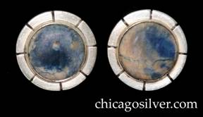 Kalo earrings, pair, screw backs, round with eight deeply chased lines radiating out from bezel on wide flat edge, centering round blue-white cabochon bezel-set stone.