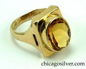 Kalo ring, handwrought in 14K yellow gold with large central faceted citrine in a rectangular gold frame with pierced geometric cutouts on shank.  Nice weight. Engraved M.F.T. April 25, 1927.