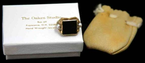 Edward Oakes ring with original tan leather pouch and white box with gold-stamped lettering